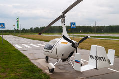 AutoGyro Europe Calidus helicopter stands on road Royalty Free Stock Images