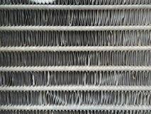 Autoheizkörperbienenwabe gemasert für Hintergrund Schärfentiefe ziehen an sich von einem Detail des persischen Teppichs zurück Stockfotos
