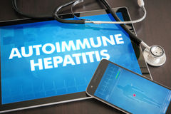 Autoimmune hepatitis (liver disease) diagnosis medical concept o. N tablet screen with stethoscope Royalty Free Stock Photos