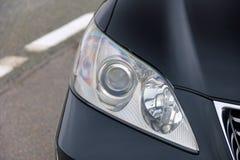 Autokoplampen Luxekoplampen stock afbeeldingen