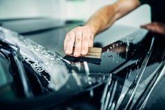 Autolackschutz, Nahaufnahme der transparenten Folie lizenzfreie stockbilder