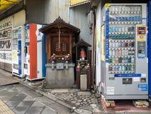 Automat und jinja gemacht durch Holz Lizenzfreie Stockbilder