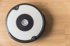 Automate robot vacuum clean floor technology. For help housewife concept royalty free stock image