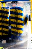 The automated carwash. Striped in yellow and blue color stock photos