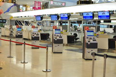 Automated check in at airport. Multiple check-in machines for automating check in at Narita Airport, Japan Royalty Free Stock Images