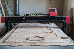 Automated cutting CNC machine in wood work shop.  Royalty Free Stock Images