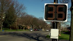 Automated digital sign that displays the speed that cars are traveling at. Video of automated digital sign that displays the speed that cars are traveling at stock footage