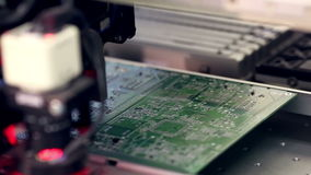 Automated electronics parts manufacturing line. Citcuit board production. stock video footage