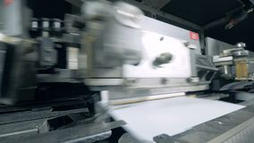 Automated equipment moves books, typographic facility. 4K stock footage