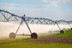 Automated Farming Irrigation Sprinklers System in Operation Stock Photo