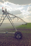Automated Farming Irrigation Sprinklers System in Operation Royalty Free Stock Image