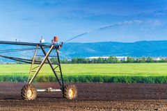 Automated Farming Irrigation Sprinklers System in Operation Stock Photography
