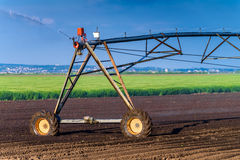 Automated Farming Irrigation Sprinklers System in Operation Royalty Free Stock Photo