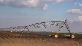 Automated Farming Irrigation Sprinklers System in Operation on Cultivated Agricultural Field stock video