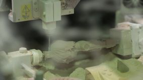 CNC mill in the process of creating a wooden figurine. Automated industry. Automated industry. CNC mill in the process of creating a wooden figurine stock footage