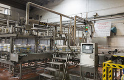 Automated keg filling line in brewery. Royalty Free Stock Photos