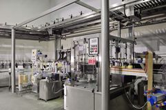 Automated labeling machine. In a modern winery Stock Photography