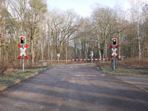 Automated level crossing with the barriers down Stock Photos