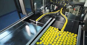 Automated line for marshalling bottles of drugs. Royalty Free Stock Photography