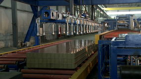 Automated machine for moving sandwich panels stock footage