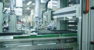 Automated machine in a production line. Of parts for the automotive industry stock footage