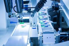 Automated picking robotic in assembly production line. Working in smart factory, Industry 4.0 concept Royalty Free Stock Image