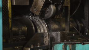 Automated process of forming humps on metal blanks for cars wheels, close-up. stock footage