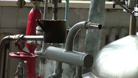 Automated production of medicines. Worker turns the valve in the pipe.  stock video