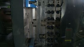 Automated production of plastic parts in a large factory. Automated mass production of plastic parts in a large factory stock footage
