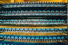 Automated round multilevel conveyor machine in bakery food factory royalty free stock photos