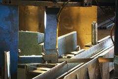 Automated saw cutting stainless steel Royalty Free Stock Photos