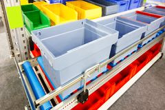 Automated storage warehouse with blue plastic crates Stock Images