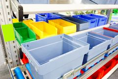 Automated storage warehouse with blue plastic crates Stock Image