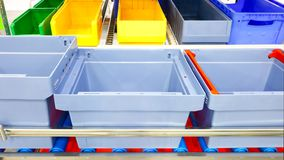 Automated storage warehouse with blue plastic crates Royalty Free Stock Photo