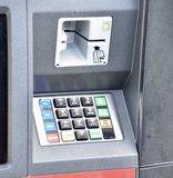 ATM Machine Keypad for Cash Withdrawal. An Automated Teller Machine dispenses money to bank customers around the clock. A keypad allows users to input their royalty free stock photo