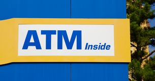 Automated Teller Machine Inside Sign stock images