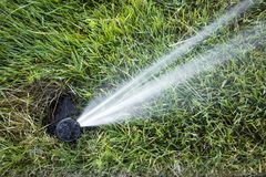Automated underground sprinkler Royalty Free Stock Image