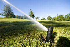 Automated underground sprinkler Stock Photography