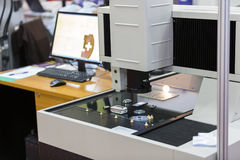 Automated Vision Systems. Operator inspection high precision part by aotumate vision system Stock Photography