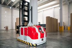 Automated warehouse (paper) with robotic forklift royalty free stock photography