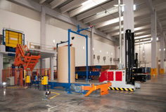 Automated warehouse (paper) with robotic forklift Stock Images