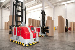 Automated warehouse (paper) with robotic forklift royalty free stock photos