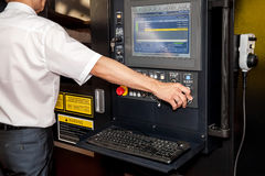 Automated workplace, computer panel of industrial machinery. Automated workplace, engineer's hand on the working computer panel of industrial machinery royalty free stock photography