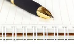 Automatic ballpoint pen and notepad on white background. Automatic ballpoint pen and notepad isolated on white background royalty free stock photos
