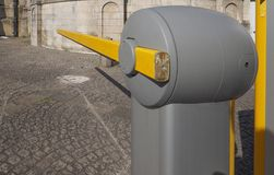 Automatic parking barrier. Automatic barrier for a car parking lot stock photography
