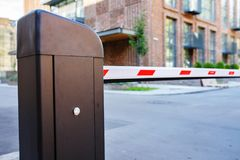 Automatic barrier and security system. Security system for building access - barrier gate stop. Automatic Rising Arm Or Drop Barrier. Intelligent Straight Pole Royalty Free Stock Photo