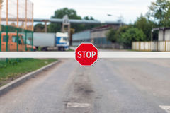 Automatic barrier with a STOP sign. Stock Photos