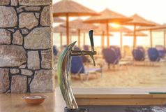 Automatic beer barrel for beat refreshment liquid cold pint of beer. On beach bar Stock Photo