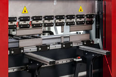 Automatic bending and folding metal sheet machine Royalty Free Stock Images