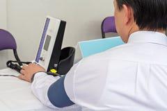 Automatic blood pressure monitor Stock Photo